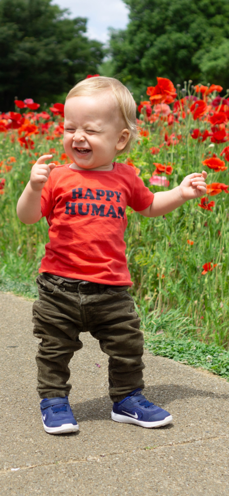 Little boy showing us how to be happy